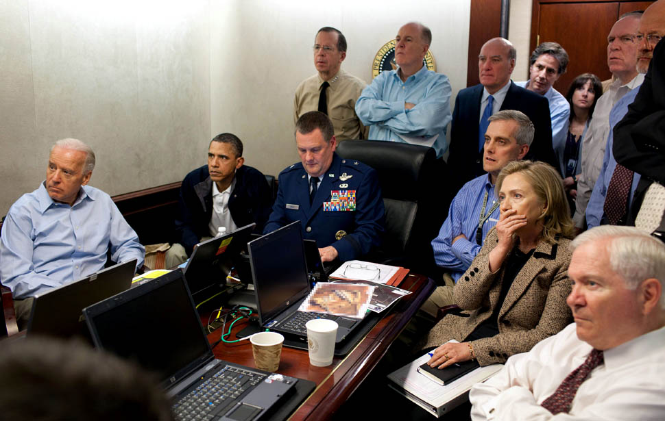 President Pbama and National Security Team receive an update on Bin Laden operation.