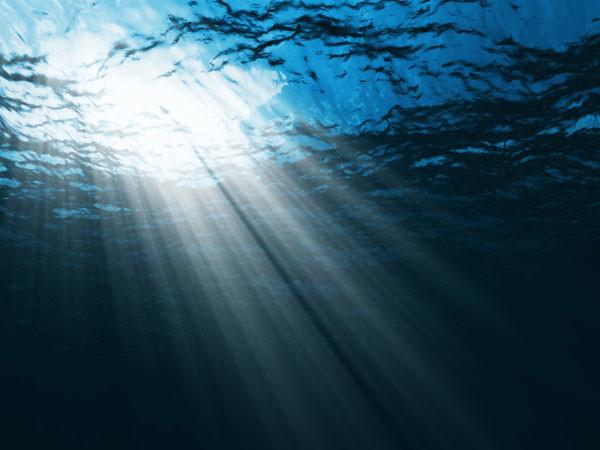 Océanos: Rayo de sol sobre suelo marino