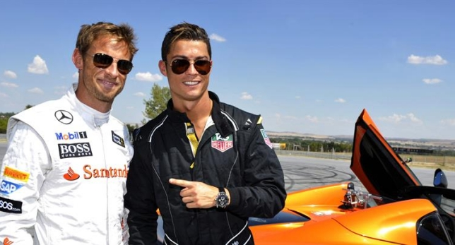 Cristiano Ronaldo con el corredor de fórmula Jenson Button